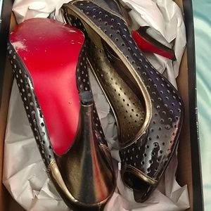 Unlisted brown and gold heels with red bottoms